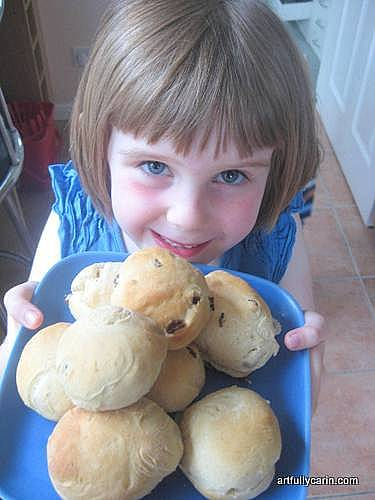 Girl with currant buns