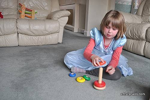 girl playing with stacking rings
