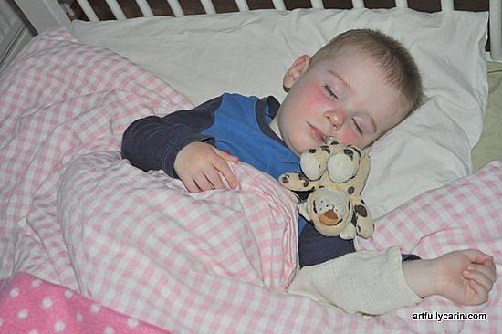 Sleeping boy with toy