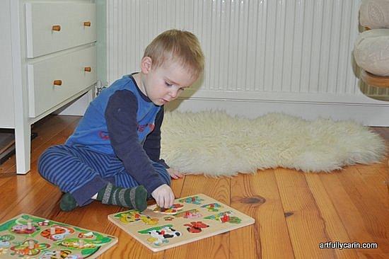 boy doing jigsaw puzzle
