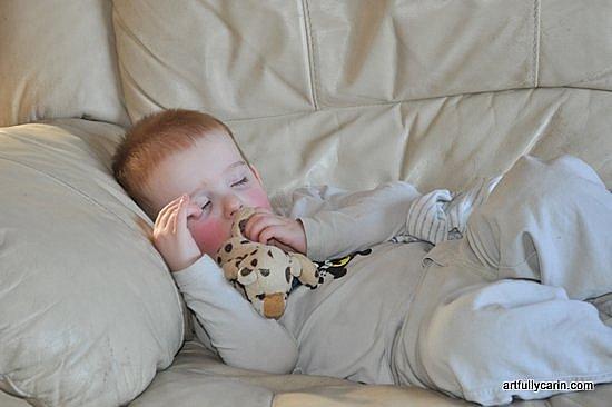 boy asleep on the sofa