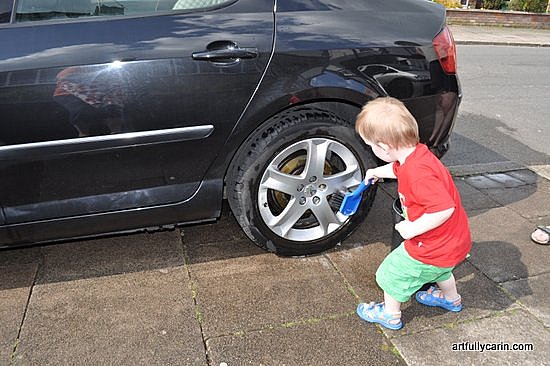 boy cleaning car